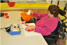 Picture: woman using a mixer with adapted switch