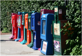 Picture: newspaper boxes along sidewalk