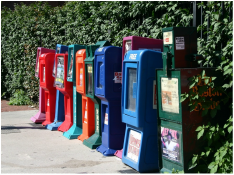 Picture: newspaper boxes on sidewalk