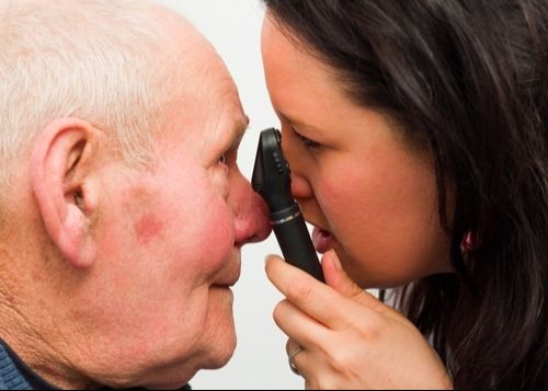 Eye doctor examining a man's eye
